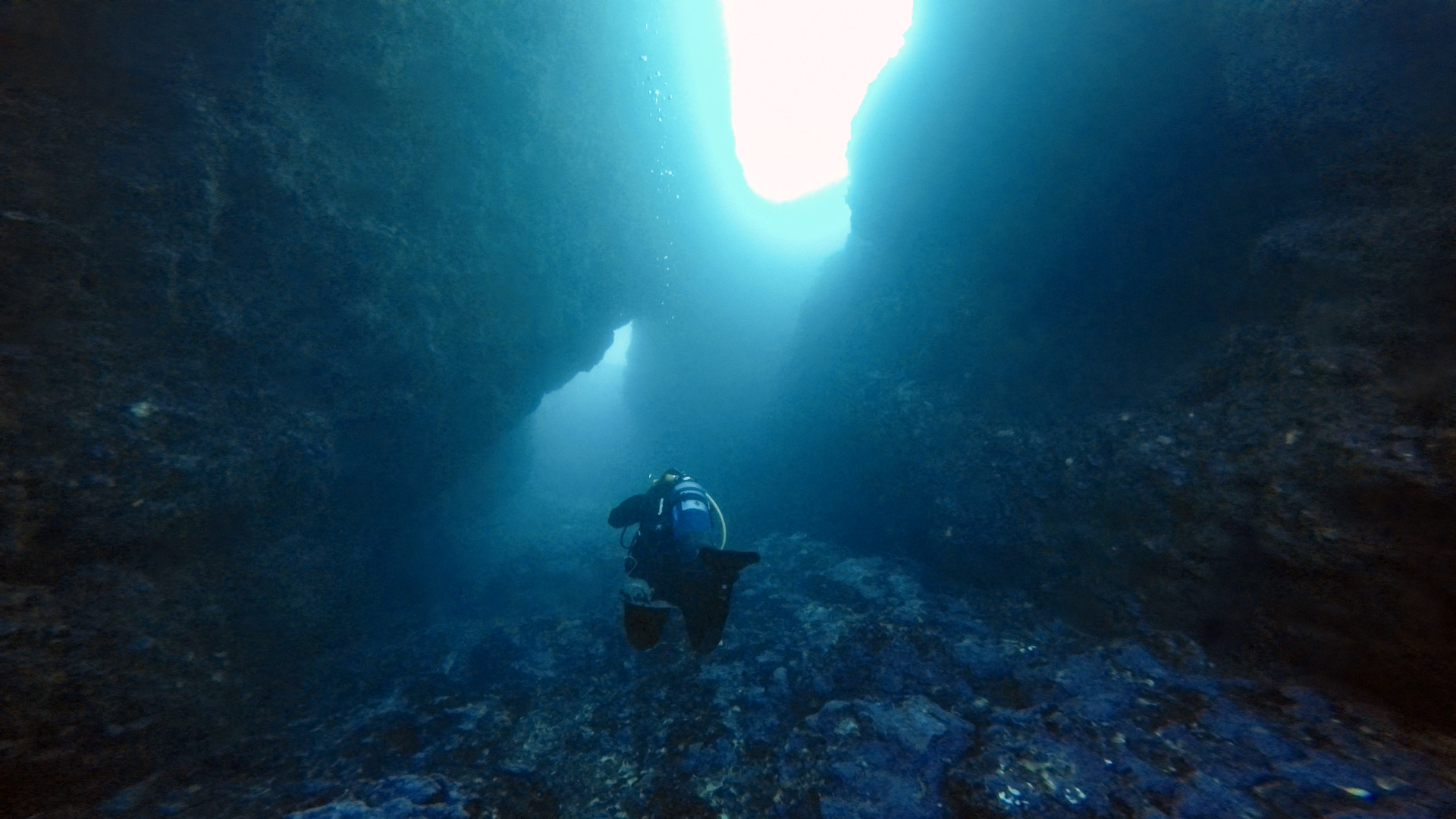 Diver entering the L'Ahrax Point tunnel from the inland sea
