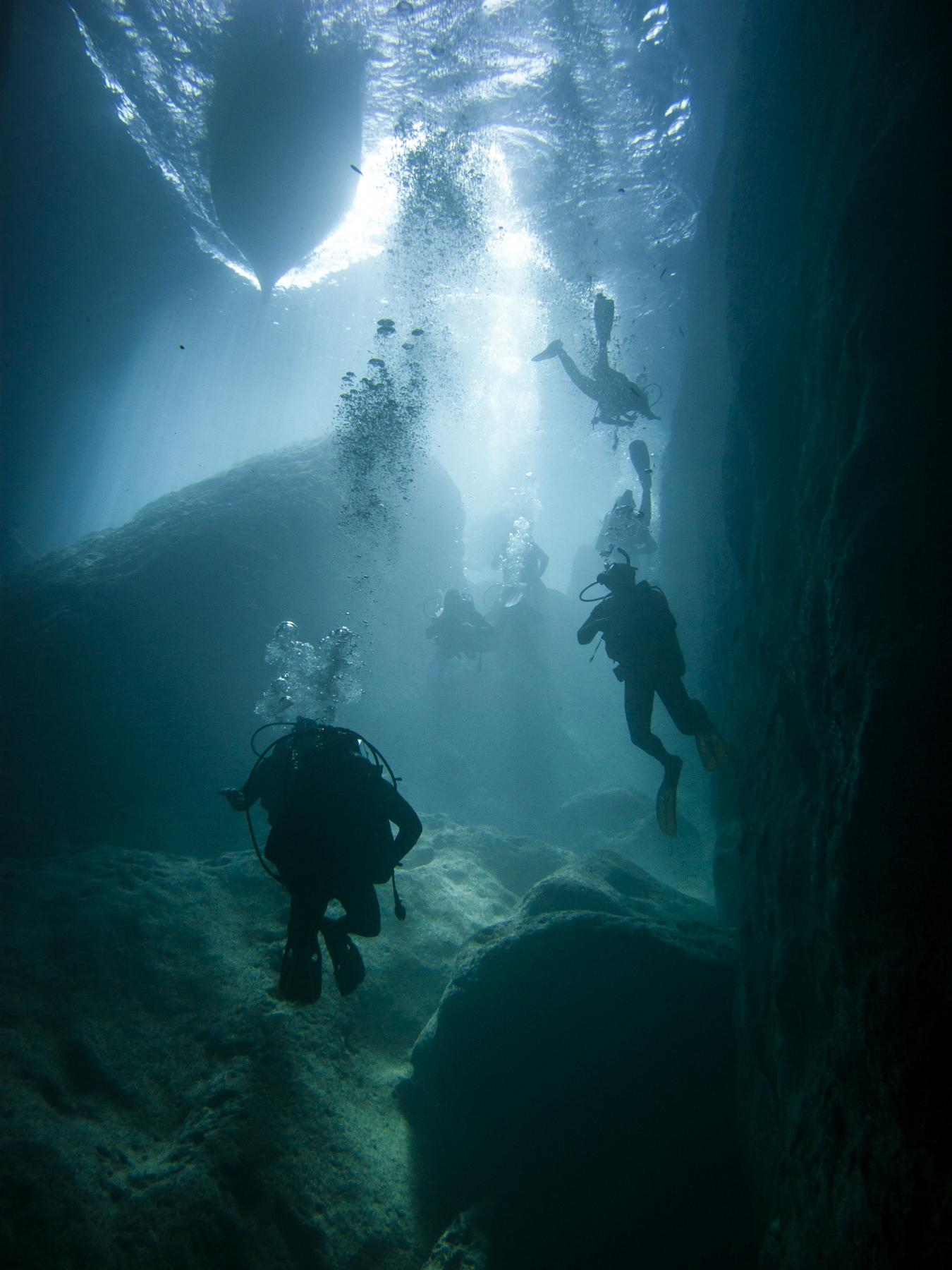 Divers at the tunnel entrance from Inland Sea