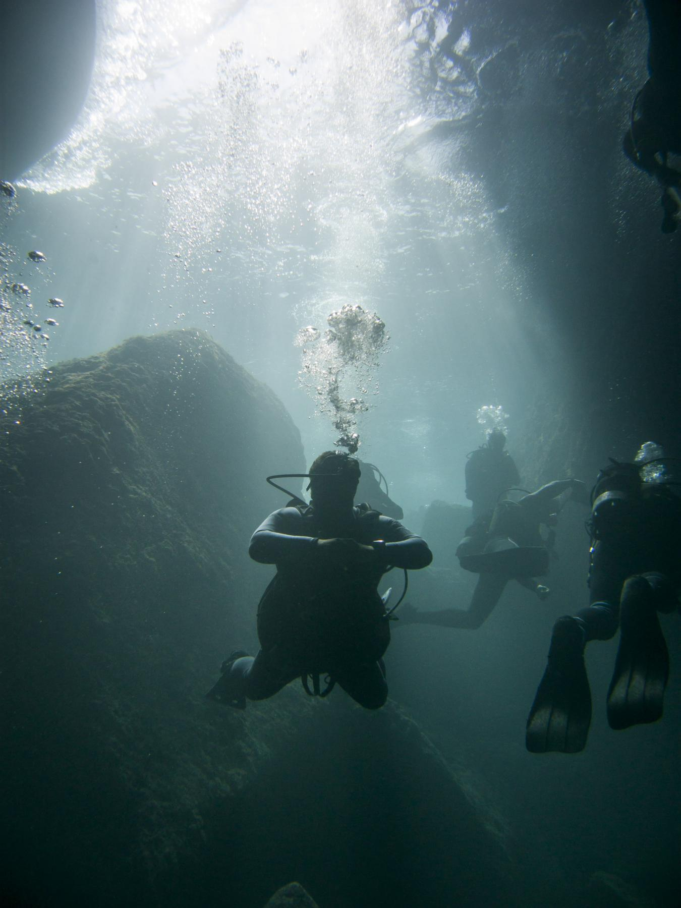 Divers entering the tunnel at Dwejra