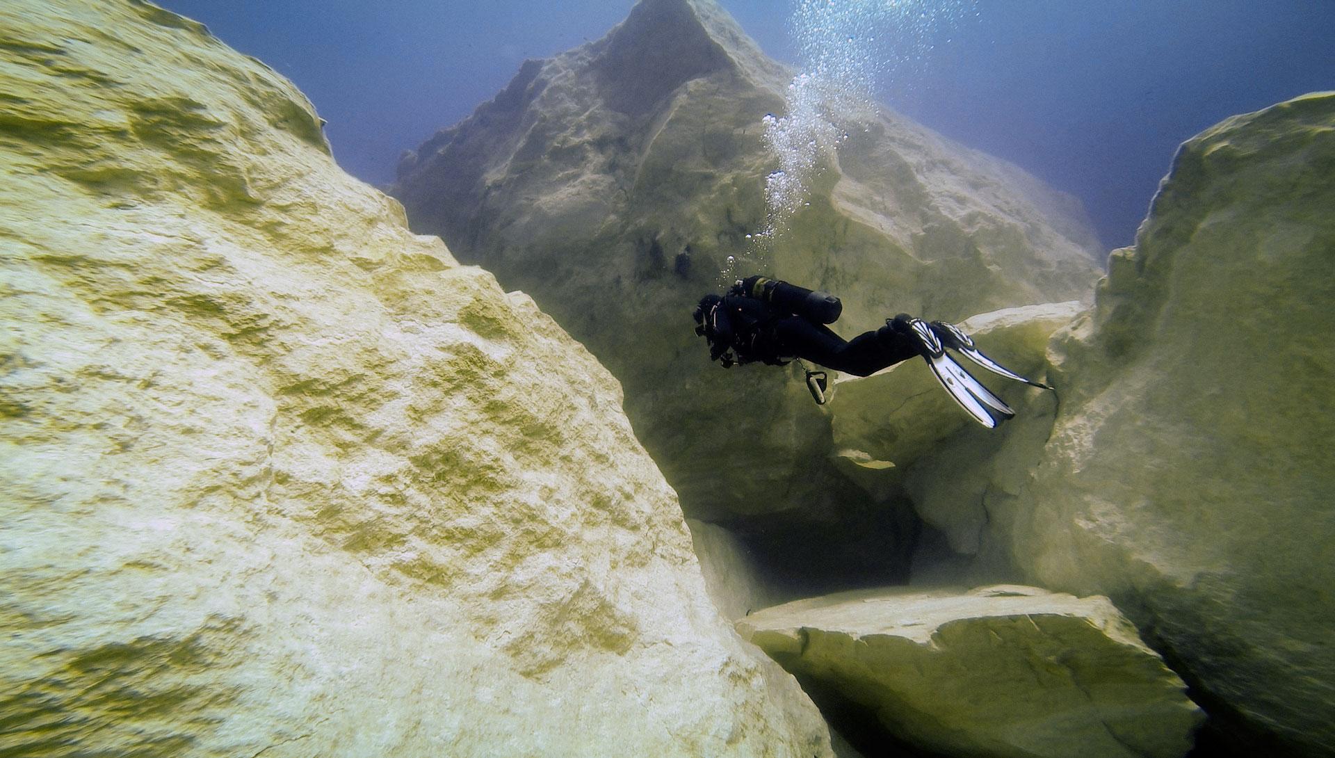 Diver exploring Azure Reef
