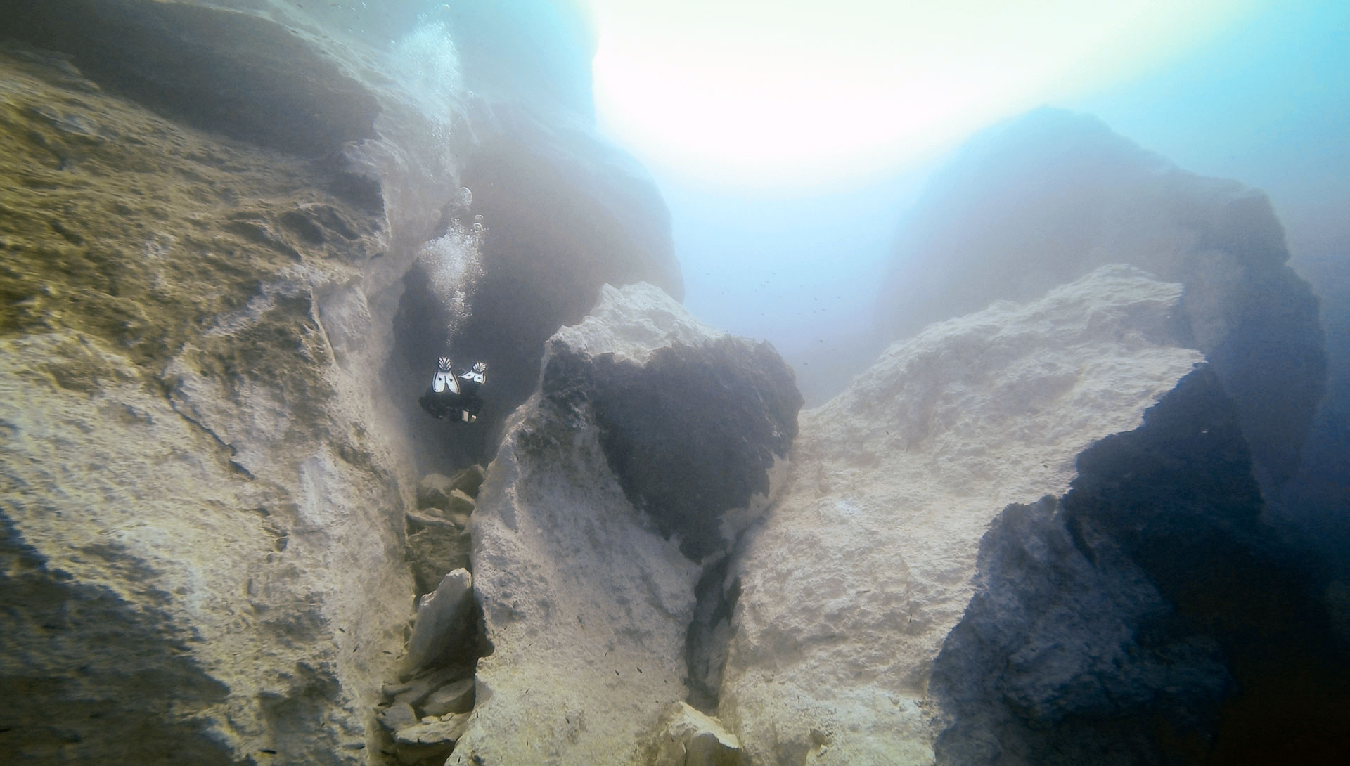 Diver between the huge boulders