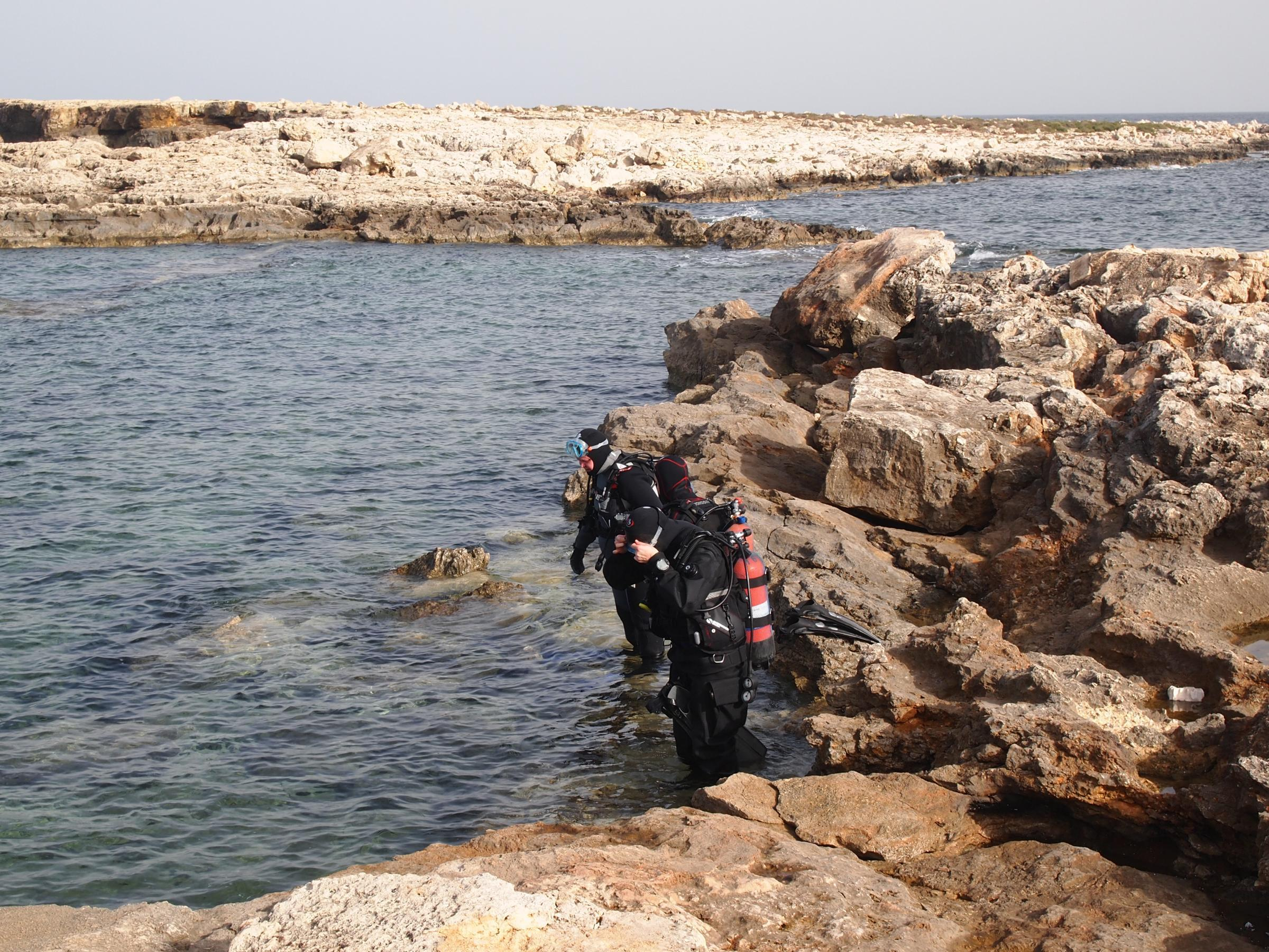Divers entering the Qawra Point pool