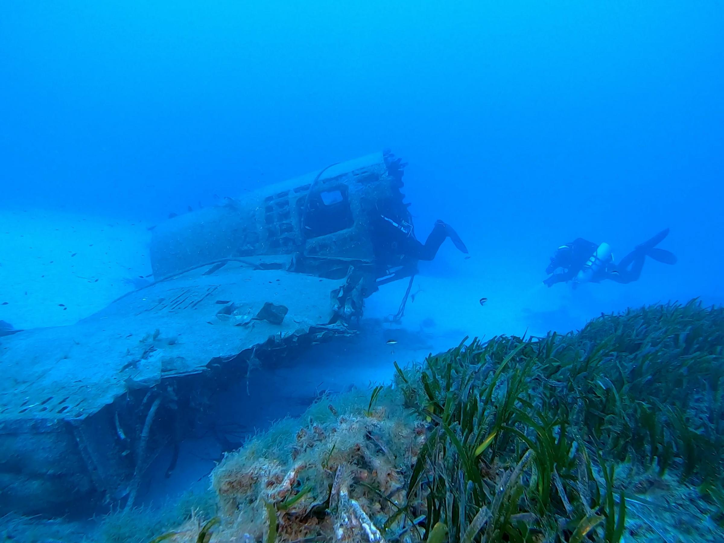 The wreck with a glimpse of the reef [Adam Sant]