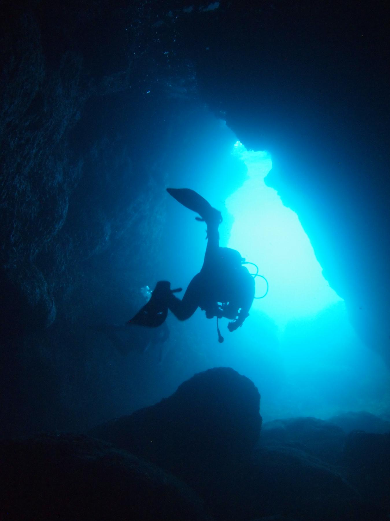 Diver exiting the cave